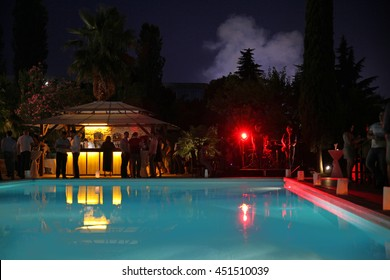 Nightlife around a hotel pool