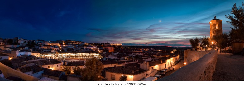 Nightlife at Chinchon in Spain at sunset with half moon world heritage