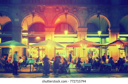 Nightlife of popular lively Placa Reial in Barcelona, Spain