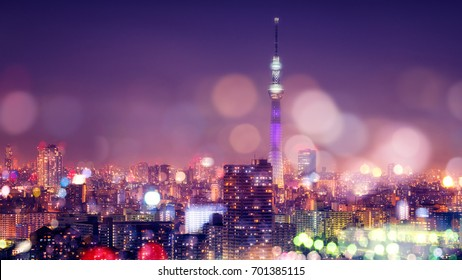 Nightlife in Tokyo. Tokyo Sky Tree with Blur Bokeh Lights Decoration in Colorful Filter. Tokyo Cityscape Background. Night sky and nightlife concept in Tokyo city.