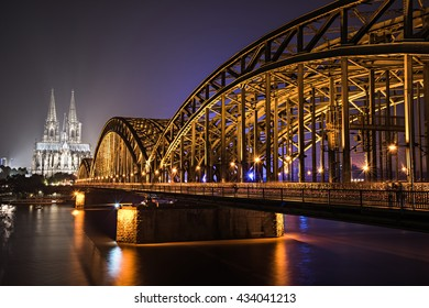 (Night/Long exposure shot) Kolner/Cologne Cathedral in distance through the rail bridge of Koln