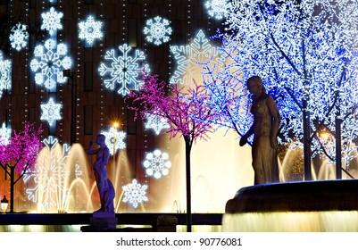 nightly colorful christmas illumination, Plaza Catalunya, Barcelona, Spain