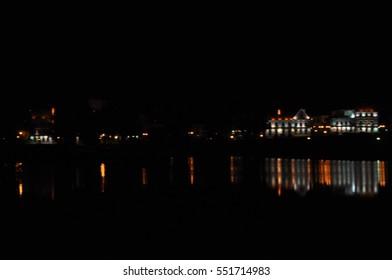 Nightly landscape of skyscrapers near river