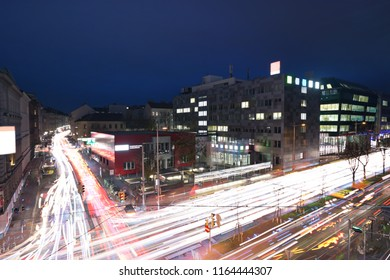 Nightly traffic in Vienna on the Waehringer Guertel road intersection with Gentzgasse aerial view. WKO and WIFI campus in background. Car light trails of 14 minutes duration.