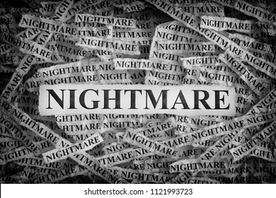 Nightmare. Torn pieces of paper with the words Nightmare. Concept Image. Black and White. Closeup.