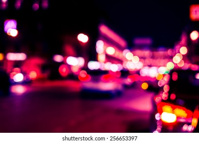 Nights lights of the big city, cars at night on the avenue. Image in red-blue toning