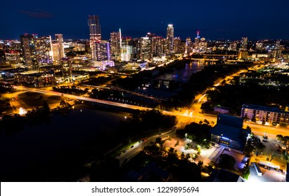 Nightscape Blue Hour aerial drone view above Austin , Texas , USA Skyline Cityscape glowing right after sunset in the urban modern capital city of AUSTIN