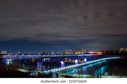 Nightscape of the highlevel bridge in Edmonton alberta lit up with paris colors following the paris attack.