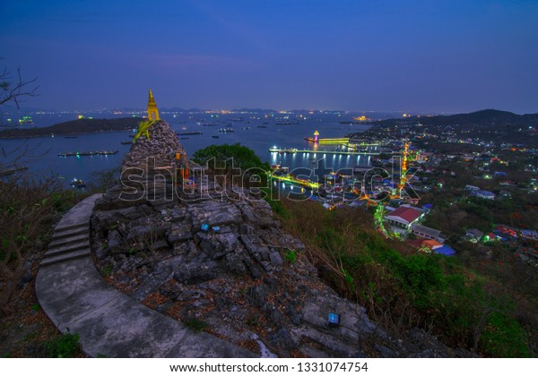 Nightscape of Pagoda buddha Footprint of Buddhism on big hill in Ko Si Chang Island Chonburi province,Popular tourist destination in Thailand.