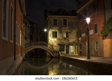 Nightshot of a Canal in Venice
