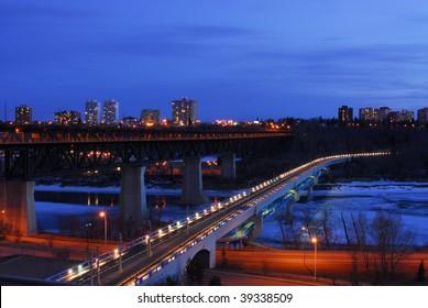Nightshot of low and high bridges and the still frozen north saskatchewan river, edmonton, alberta, canada