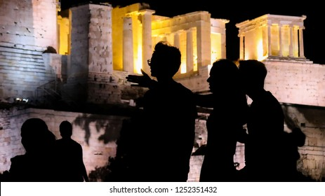 Nightshot photo of Acropolis, Athens, Greece. Silhouettes of tourists, visitors and locals at the Acropolis.