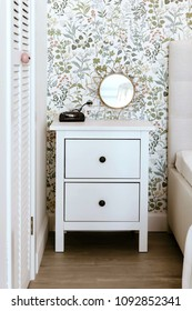 Nightstand in the white bedroom