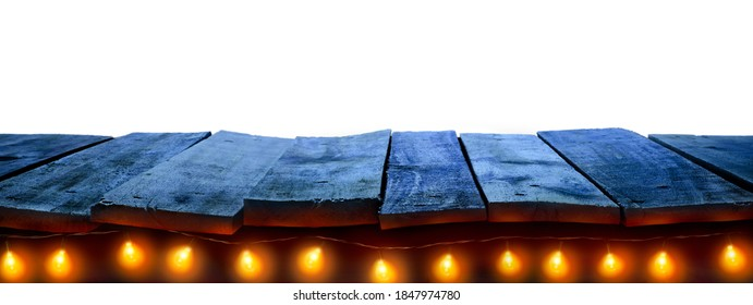A nighttime Christmas, New Year wood tabletop template with fairy lights and white background to display products on. To go with a cooler, nighttime background.