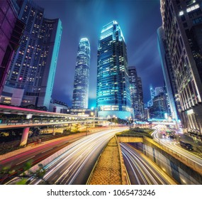 Nighttime cityscape of Hong Kong with skyscrapers and highways. Scenic travel background.