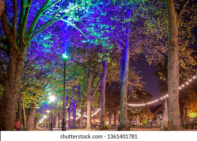 Nighttime at the embankment in Bedford United Kingdom with love lights lighting the trees and walkway