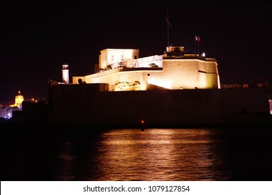 Nighttime illumination of Fort Saint Angelo, in the  Grand Harbor of Valletta, Malta