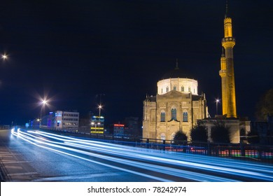 Night-time long-exposure photo of a road bypassing small mosque, Istanbul, Turkey