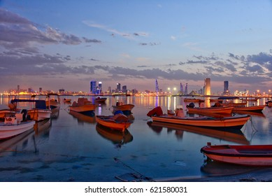 A night-time shot of the Bahrain capital, Manama, from the Muharraq coast, with the boats reflected in the still waters of the Arabian Sea.