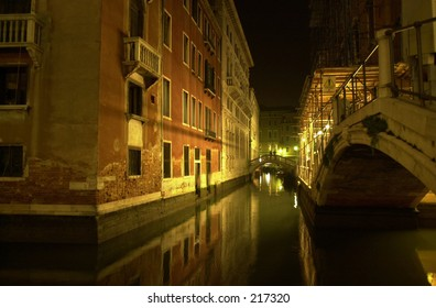 Nighttime view of a canal between buildings, Venice, Italy (black and white),
