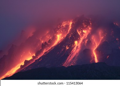 Nighttime view of glowing lava dome of Soufriere Hills volcano, Montserrat, Caribbean, 2006