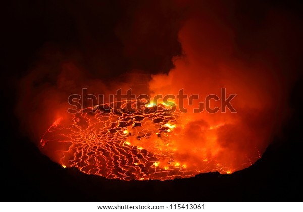 Nighttime view of lava lake in pit crater, Nyiragongo Volcano, Democratic Republic Congo