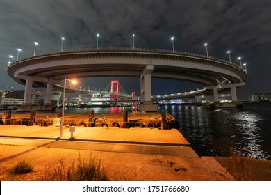 Nightview of Rainbow Bridge, illuminated in red as a sign of