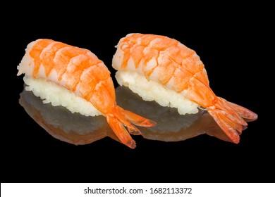 Nigiri prawn sushi. Black background, reflection, high resolution.