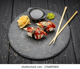 nigiri sushi with eel on black background, traditional Japanese food