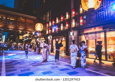 Nihonbashi, Japan - Aug 2018: COREDO Muromachi is a shopping center in a  traditional design inspired by the EDO period.During summer, many visitors will wear yukata to enjoy digital fireworks mapping