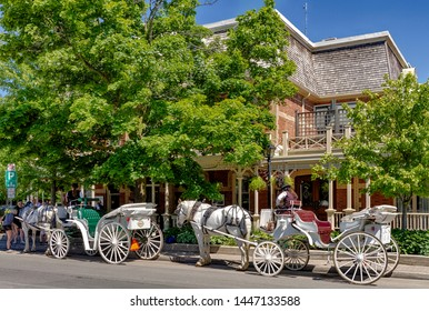 NIiagara on the lake, Ontario, Canada - June 14, 2018: The Historic Prince of Wales Hotel in Niagara On The Lake. In front of it you can rent a Carriage ride through the city.
