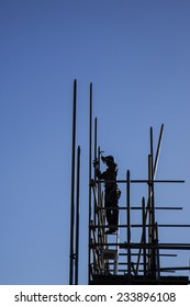 NIJKERK, NETHERLANDS, 24 NOVEMBER 2014: construction worker on top of new concrete building with blue sky