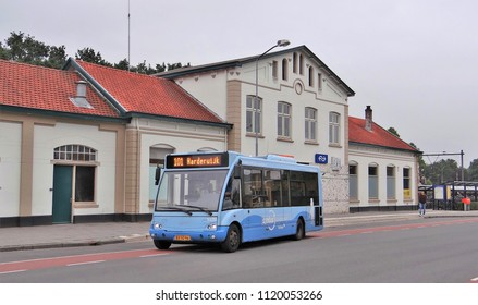 Nijkerk / Netherlands - June 19 2018: A blue Optare Solo bus of Syntus / Keolis departs from the railway station of Nijkerk as bus line 101 to Putten and Harderwijk.