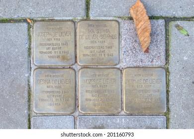 Nijkerk, Netherlands: November 21, 2013 -  Stolpersteine iin Nijkerk that recall the Jewish Family of Joseph de Rather, Netherlands