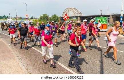 Nijmegen July 19 2017: 4Day Walking tournament contestants passing the Waalbrug near the center of Nijmegen