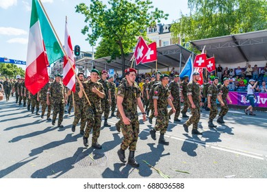 Nijmegen July 21 2017: 4Day Walking tournament Military contestants from around the world entering the Via Gladiola, the traditional last street before the finish in the center of Nijmegen