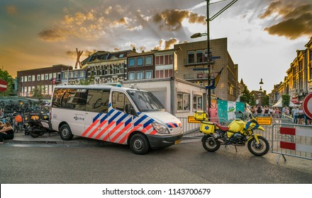 Nijmegen, The Netherlands 16th July 2018 - Police van and ambulance motorcycle parked at the entrance of the 4 days festival in Nijmegen ready to react for a emergency call