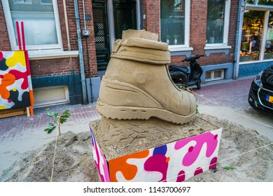 Nijmegen, The Netherlands 16th July 2018 - Sand sculpture of shoe made for the annual 4 Days March