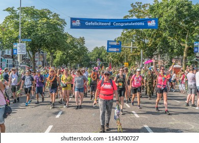 Nijmegen, The Netherlands 19th July 2018 - Walkers passing the finish line at the Wedren on the last day of the 4 day walking tournament in Nijmegen