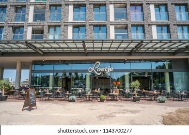 Nijmegen, The Netherlands 21th July 2018 - Sunny terrace of the new Loetje restaurant in Nijmegen waiting for customers