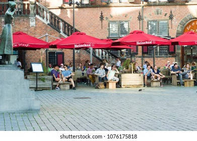Nijmegen, Netherlands - April 19, 2018: people relax and enjoy a drink at an outdoor cafe terrace.