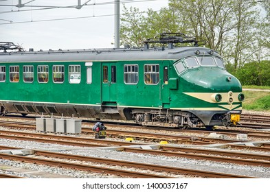 Nijmegen, The Netherlands, April 25, 2019: classic green Dutch railways Mat'54 or Dog Head train at the tracks next to the city's main railway station