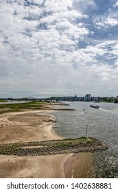 Nijmegen, The Netherlands, April 25, 2019: view from city bridge De Oversteek towards the floodplains of the river Waal, with beaches, breakwaters and in the distance the city's skyline