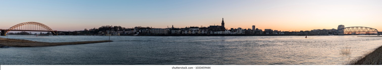 Nijmegen, The Netherlands - February 22, 2018: Panorama of Nijmgen at the river Waal with two bridges and the Stevenskerk, church, in the province of Gelderland.