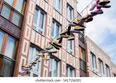 Nijmegen, The Netherlands. July 30th 2017.  Sport shoes are hanging on a line.