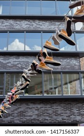 Nijmegen, The Netherlands. July 30th 2017. Many sneakers are hanging on the line during the Voeur Days March in Nijmegen.
