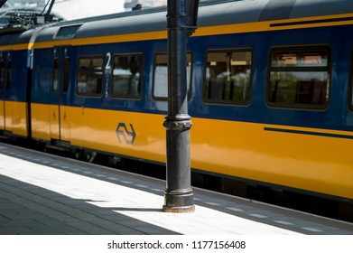 Nijmegen, The Netherlands - June 12, 2018: Railway station with Dutch NS trains reflections