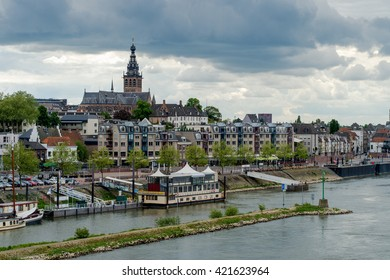 NIJMEGEN, NETHERLANDS - MAY 17, 2016: View on the Dutch city of Nijmegen with the river Waal in front on May 17, 2016.