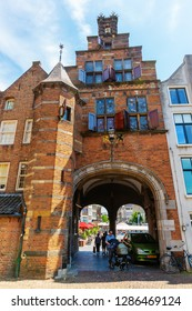 Nijmegen, Netherlands May 21, 2018: historical buildings with city gate in the center of Nijmegen. Nijmegen is the oldest city in the Netherlands