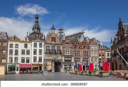 NIJMEGEN, THE NETHERLANDS - MAY 5: Central market square, with people sitting in the sun on May 5, 2015 in Nijmegen
